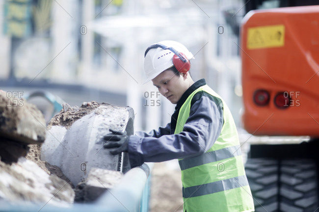 Civil engineer standing in front of an excavator