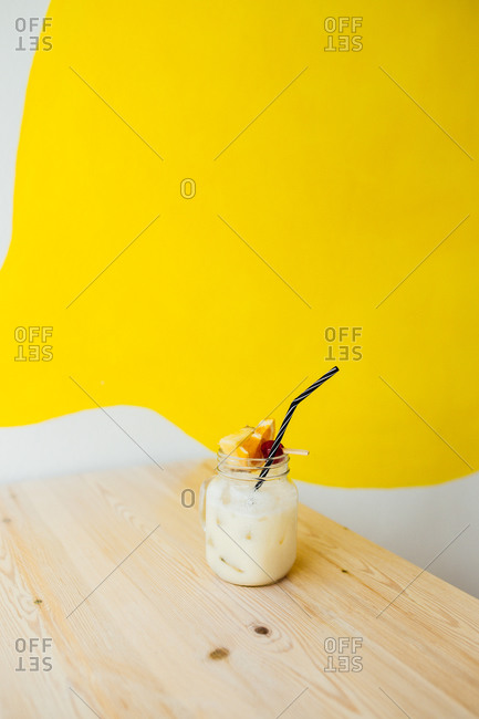 Bright & vibrant cocktail on natural wood table