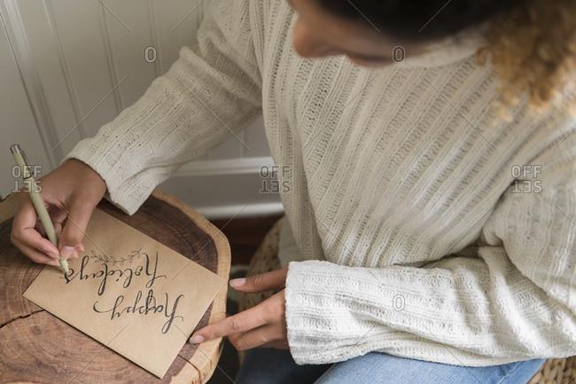 Woman writing on card