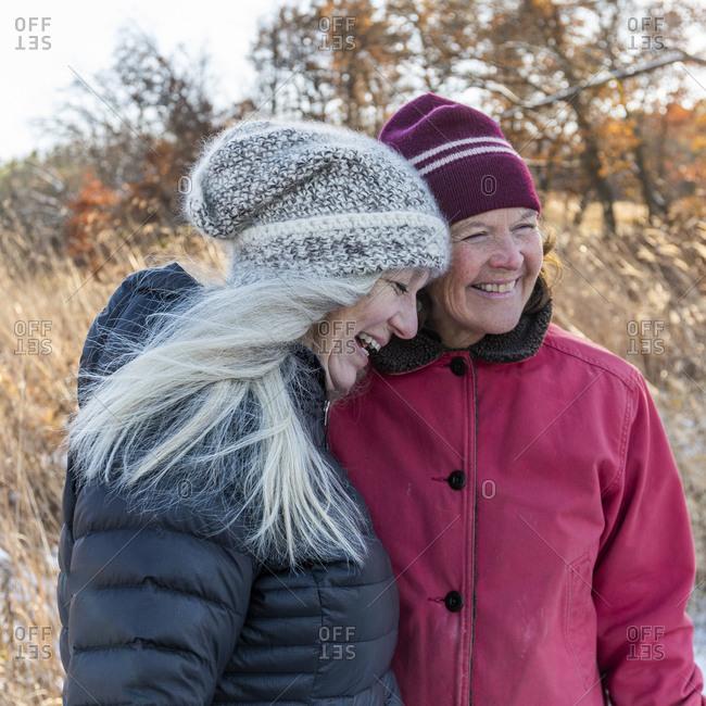 Smiling women wearing winter clothing