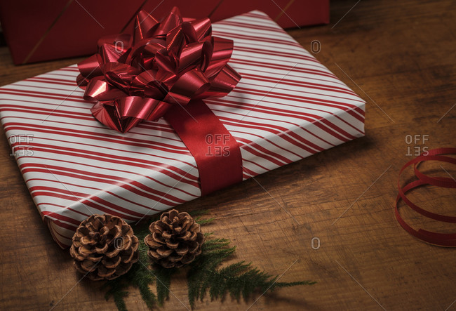 Red Christmas present by pinecones