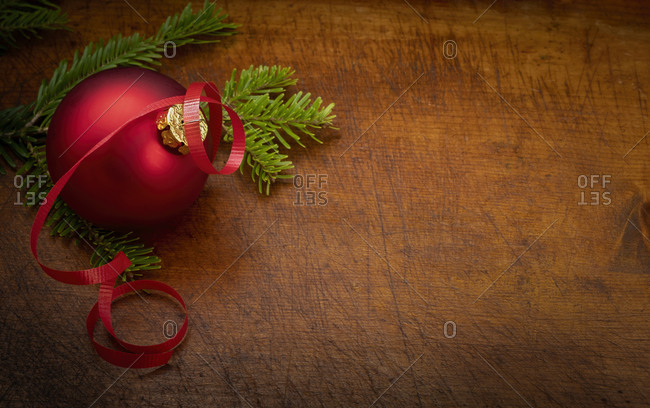 Red bauble and pine frond