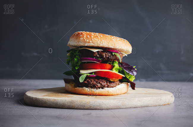 Beef burger on gray background