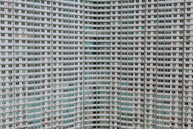 Identical windows on modern white big building of office center at Cuba