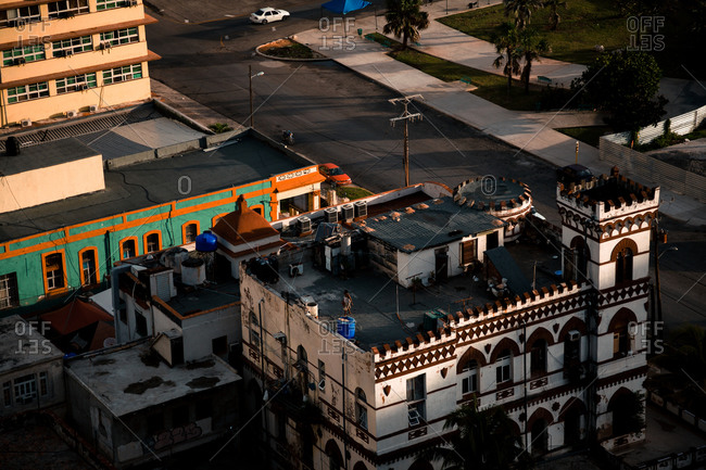 February 7, 2020: From above of colorful buildings and skyscraper with blue sky on background on streets of Cuba