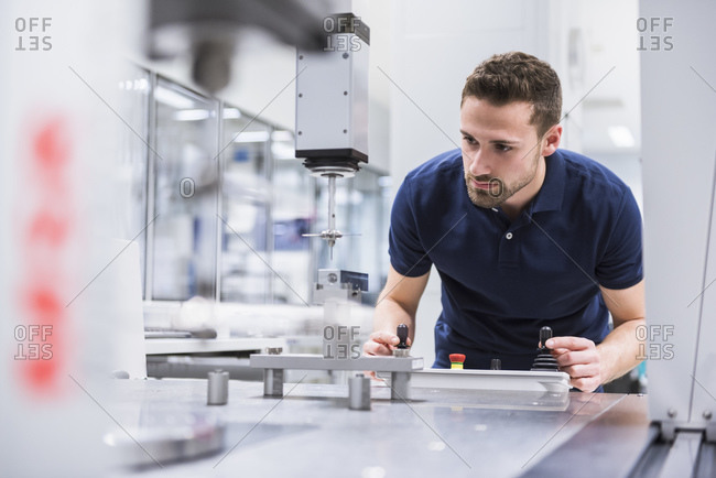 Man operating machine in testing instrument room