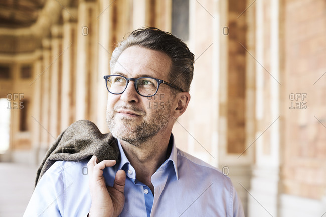Portrait of businessman with stubble wearing glasses