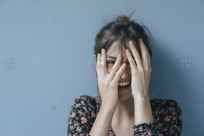 Beautiful woman covering face- portrait