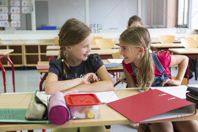 Two schoolgirls at class