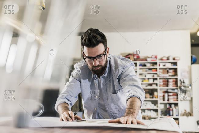 Man working on construction plan
