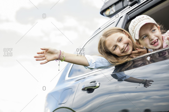 Girls sitting in car- looking out of window