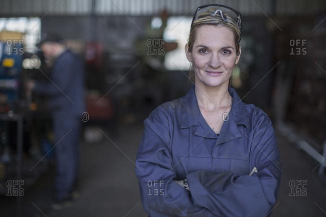 Portrait of confident female mechanic in workshop
