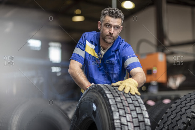 Repairman working in tire factory