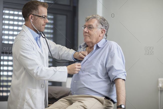 Doctor examining senior patient in medical practice