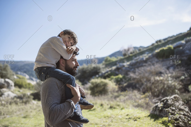 Father with young son outdoors