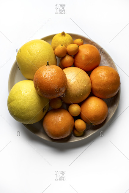 Top down of bowl of citrus fruit on a white background