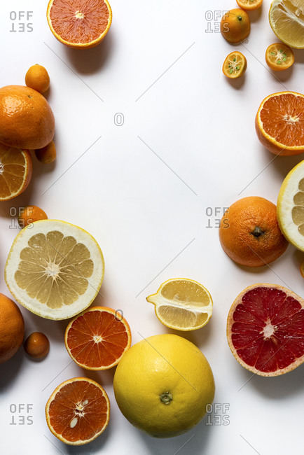 Variety of sliced citrus fruits on a light background