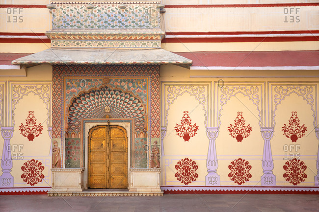 Golden colored doorway at the City Palace in Jaipur, India