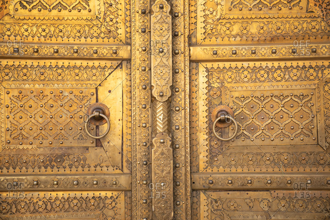 Close up of a golden colored doorway at the City Palace in Jaipur, India