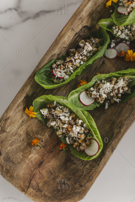 Lettuce wraps on a board on white marble surface