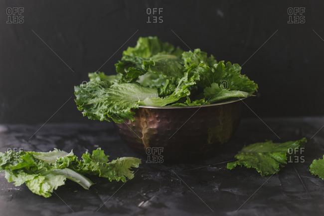 Lettuce leaves in a metal bowl