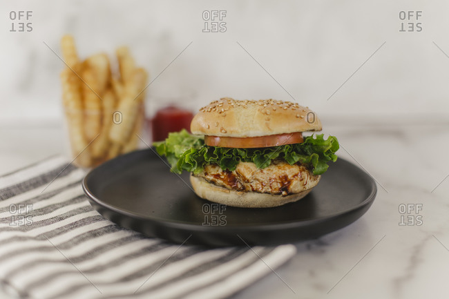 Cheeseburgers with French fries on light background
