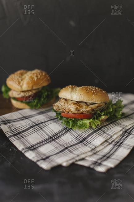 Grilled chicken sandwich on dark background