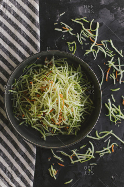 High angle view of julienne sliced veggies in a bowl