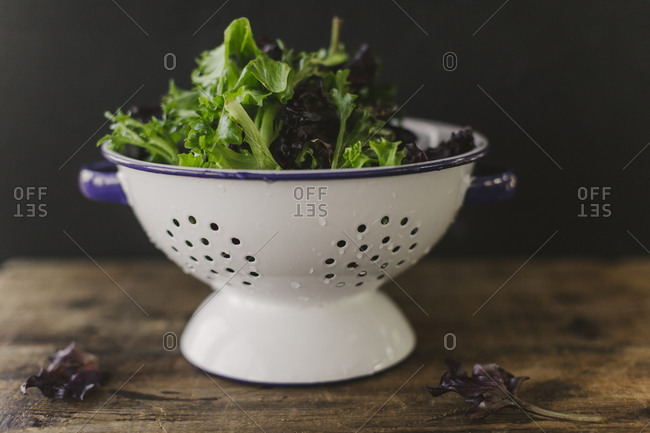 Mixed lettuce leaves in a colander