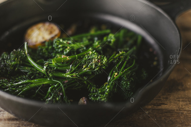 Close up of broccolini in a skillet