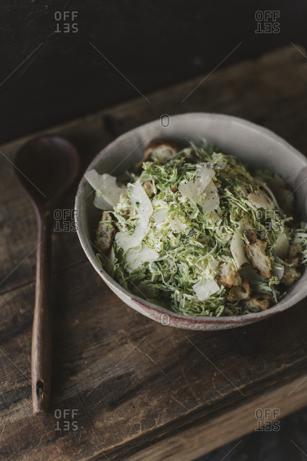 Overhead view of salad in a bowl on a rustic table