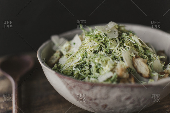 Close up of salad in a bowl on a rustic table