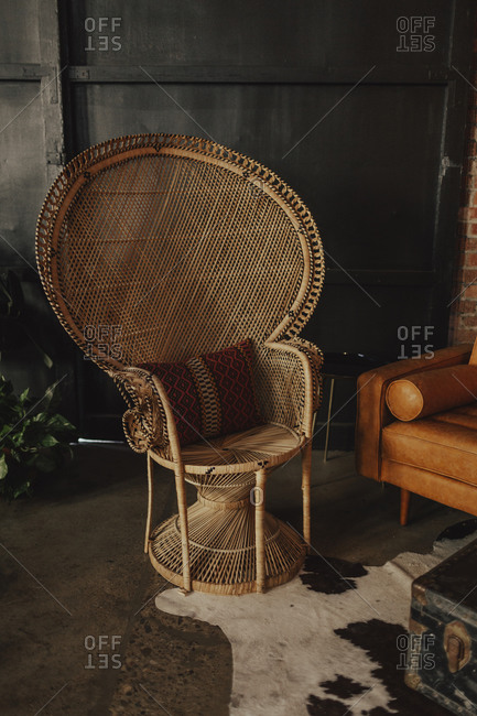 Large wicker chair with pillow