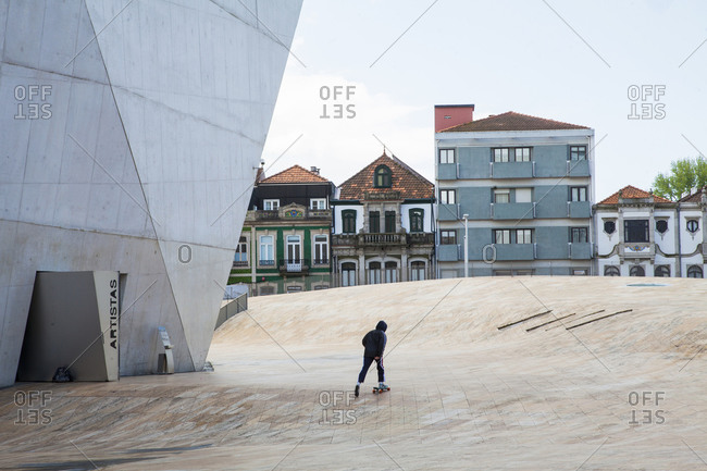 Porto, Portugal - April 18, 2019: A guy skating beside Casa Da Musical Porto, Portugal