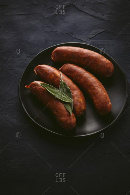 Plate of chorizo sausages high angle view