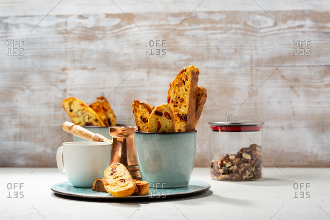 Homemade biscotti and a cup of coffee on a tray