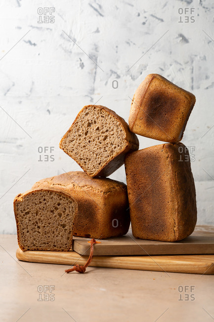 Whole and sliced Loaves of delicious rye bread