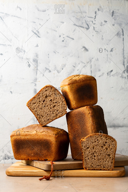 Whole and sliced Loaves of delicious wholegrain bread