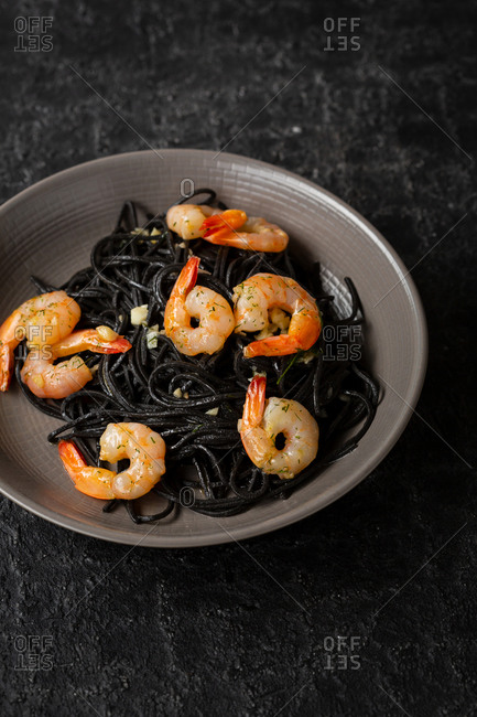 Black pasta with roasted shrimps