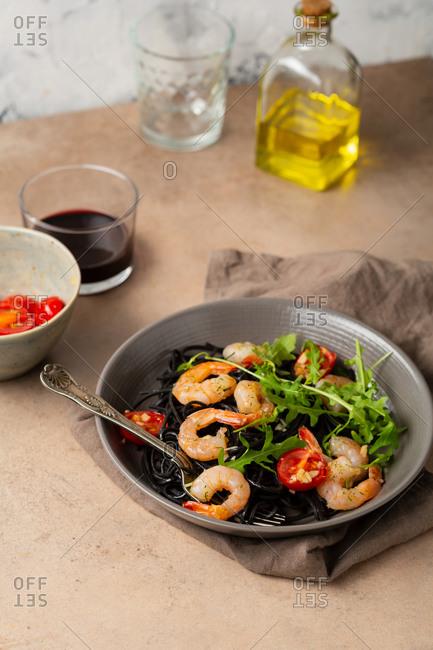 Black spaghetti with roasted tomato and prawns