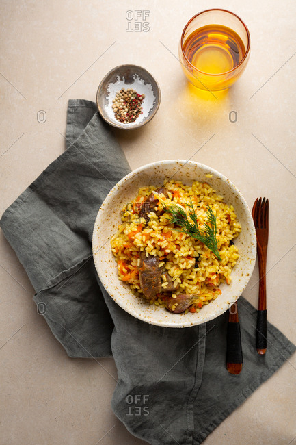 Basmati rice with goat meat on light surface