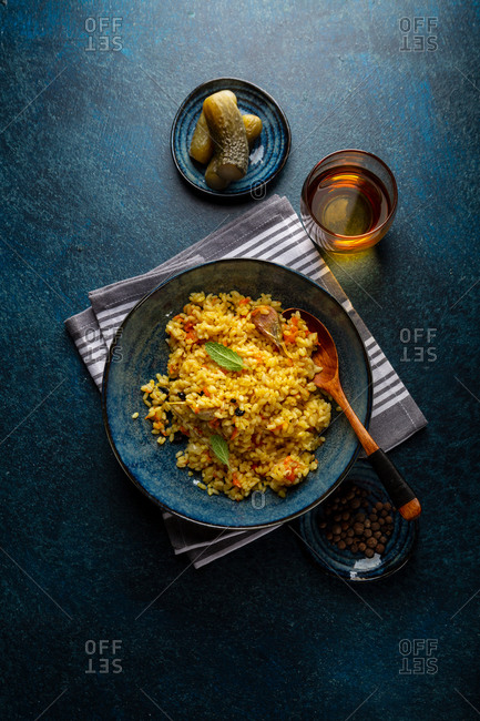 Overhead view of curry rice in bowl on dark blue background