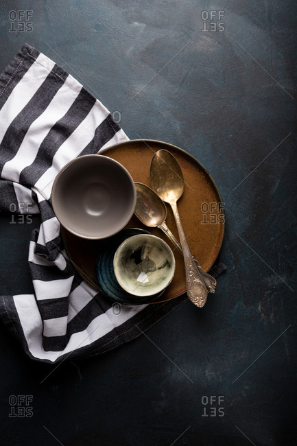 Kitchen striped cloth and dishes on a tray