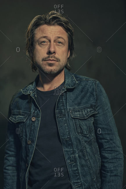 Profile view of a man wearing a denim jacket