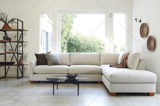 February 16, 2020: Living room with large off-white sectional sofa