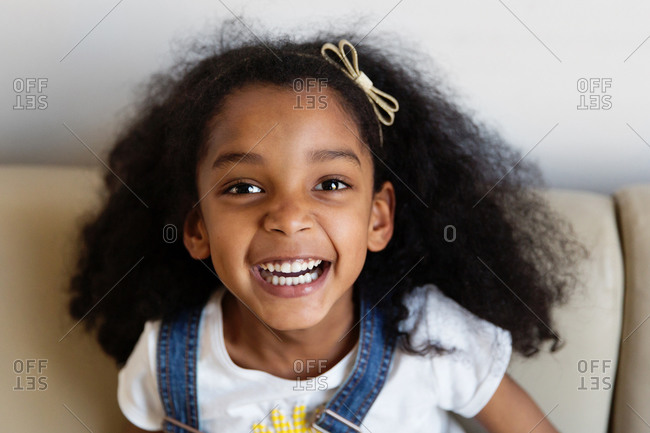 Happy young girl with afro hair