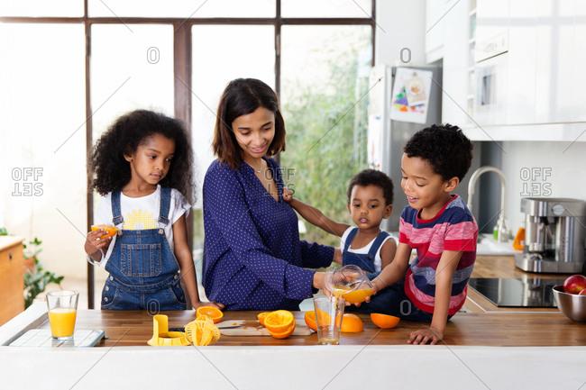 Family preparing orange juice together