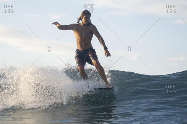Surfing the sunrise in Costa Rica
