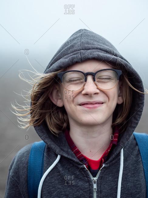 Portrait of tween eyes closed with big smile