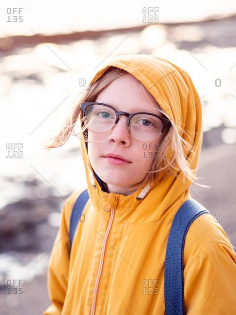 Portrait of tween wearing glasses looking at camera